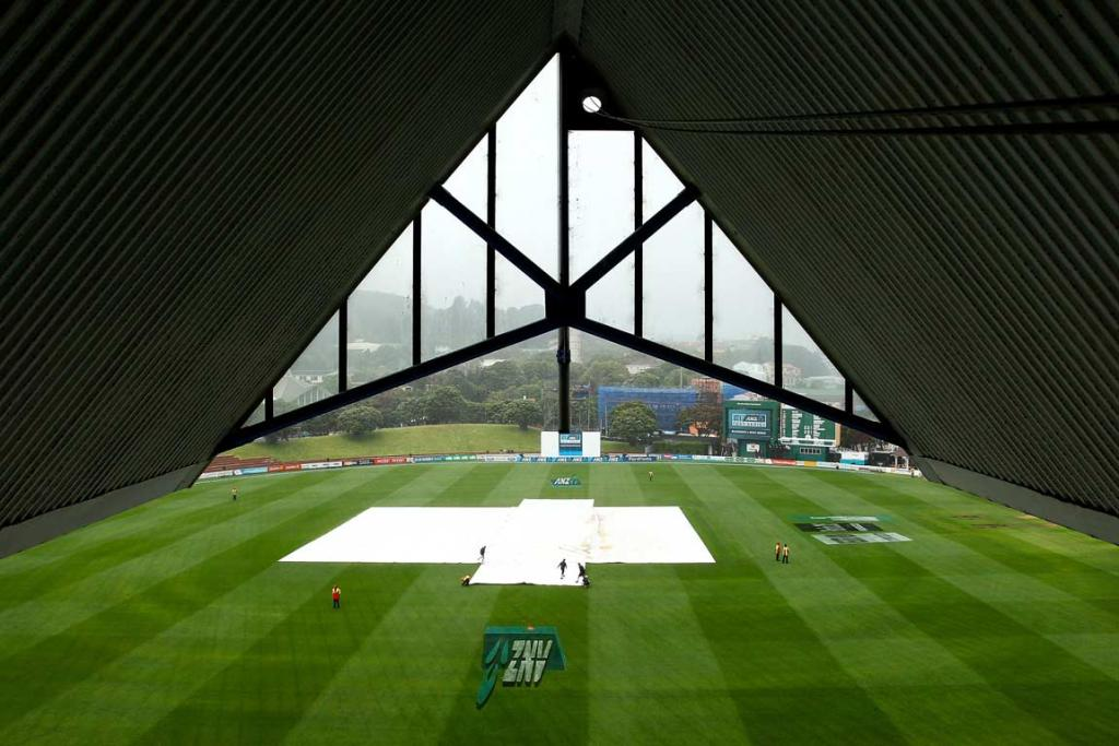 The pitch remains covered at the Basin Reserve as rain delays the start of day two.