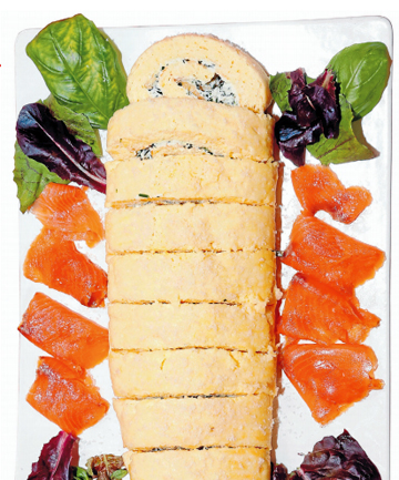 Cheese roulade with fresh basil and smoked salmon.