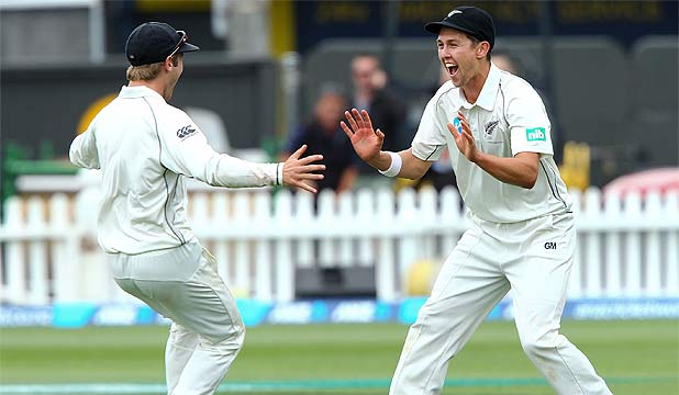 ON FIRE: Trent Boult celebrates with teammate Kane Williamson after taking a catch to dismiss Denesh Ramdin.