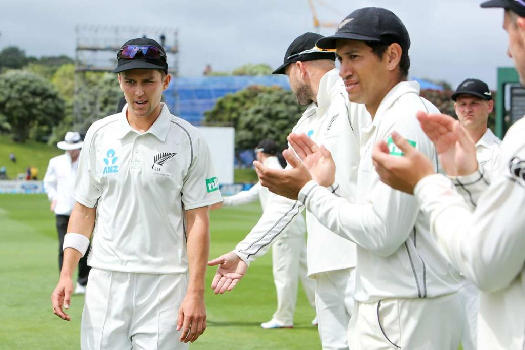 Trent Boult is clapped off the field by team-mates after taking six wickets in the West Indies' first innings.