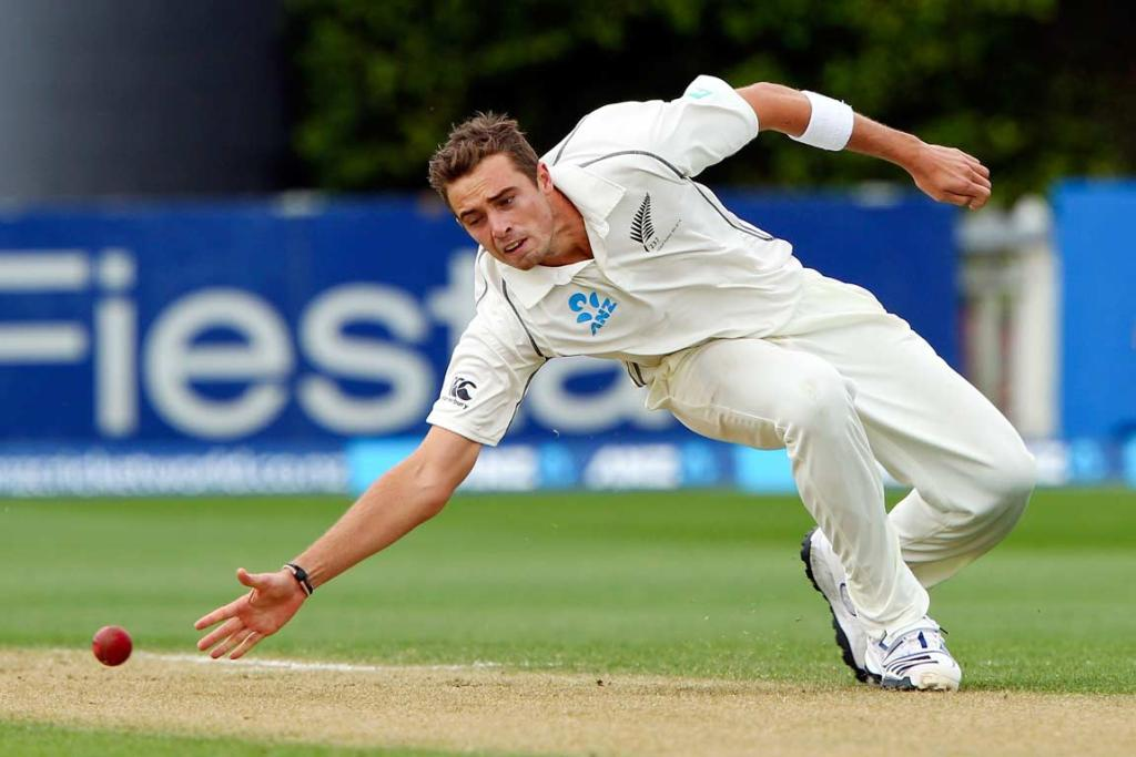 Tim Southee dives as he attempts to field the ball off his own bowling.