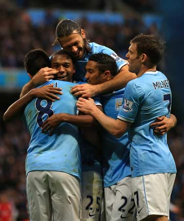 ROLLING ALONG: Manchester City players celebrate one of Fernandinho's two goals in Citeh's 6-3 demolition of leaders Arsenal.