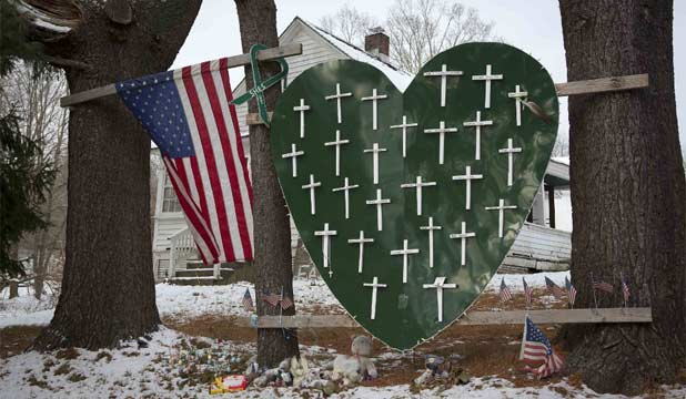 LOST LIVES: A heart is emblazoned with crosses to commemorate the 26 Sandy Hook Elementary School shooting victims on the one-year anniversary.
