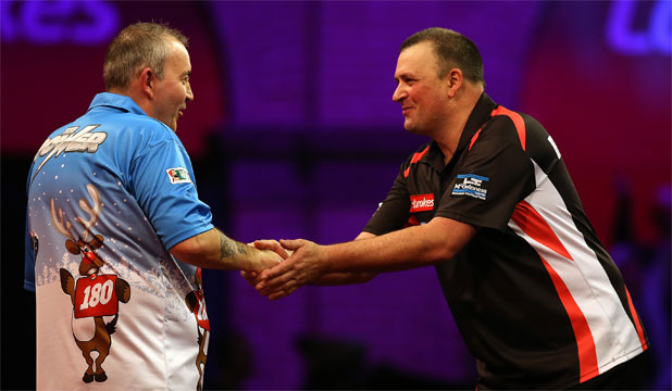Rob Szabo (right) congratulates Phil Taylor after their match at the World Darts Championships.