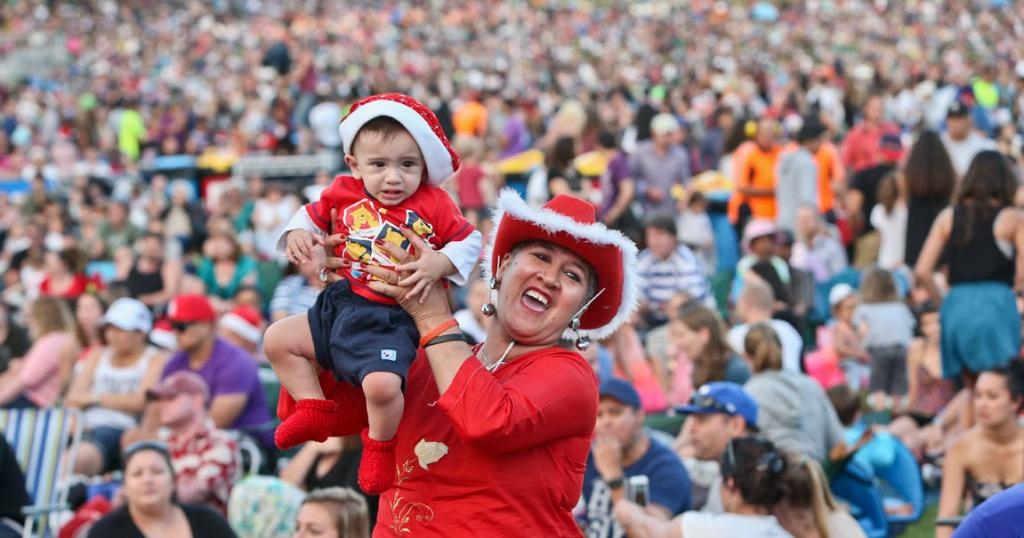 INTO THE SPIRIT: Aroha Datt with her 10 month old grandson Lucacruz Datt-Tantau at Coca Cola Christmas in the Park held at the Auckland Domain.