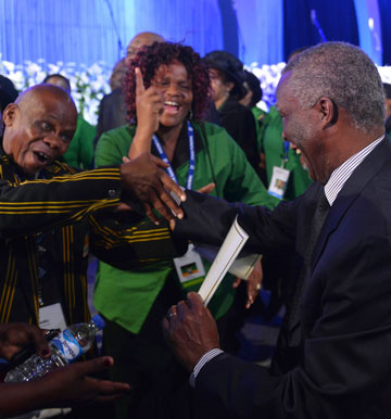 Former South African President Thabo Mbeki, right, is greeted by African National Congress supporters