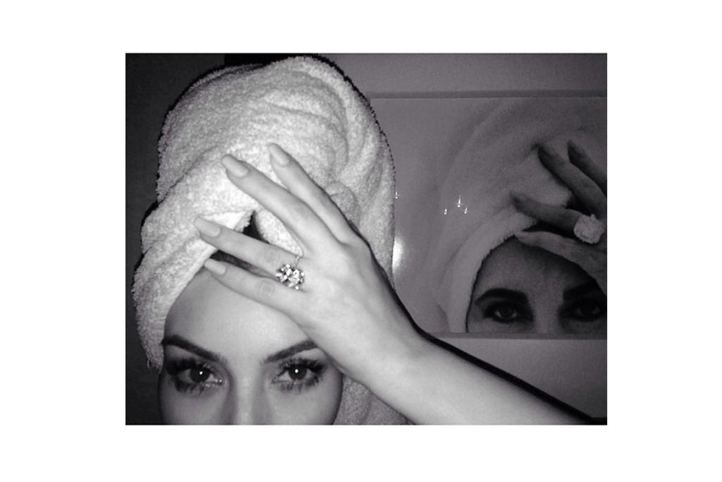 KIM KARDASHIAN: There's only one hot tamale that could make Kim Kardash's engagement ring look small; her towel seem low-thread-count and her brows unmanicured ... Elizabeth Taylor. Bow down.