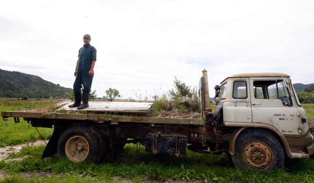 IN THE CLEAR: Wainui Bay farm assistant Rongomai Ruakere stands on a truck that was submerged up to its windows in landslide mud during the 2011 floods in Golden Bay.