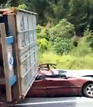 Car crushed by truck