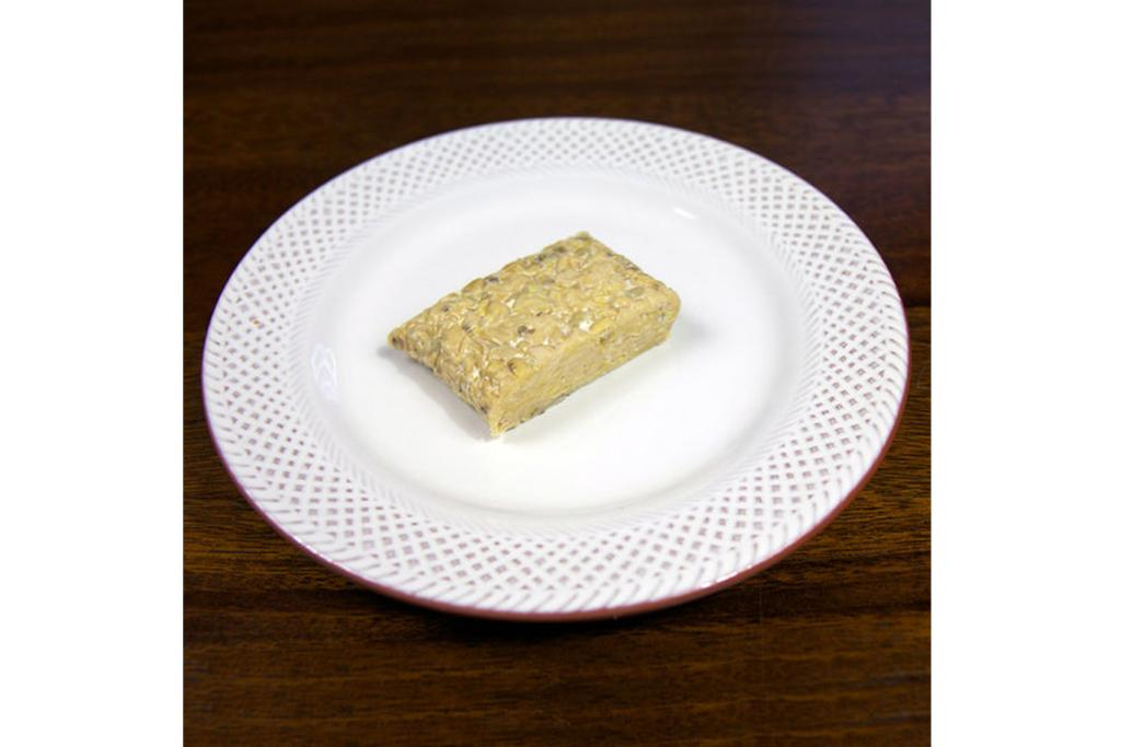 TEMPEH: 55 grams - about a quarter of your average package size (10 grams of protein; 120 calories).