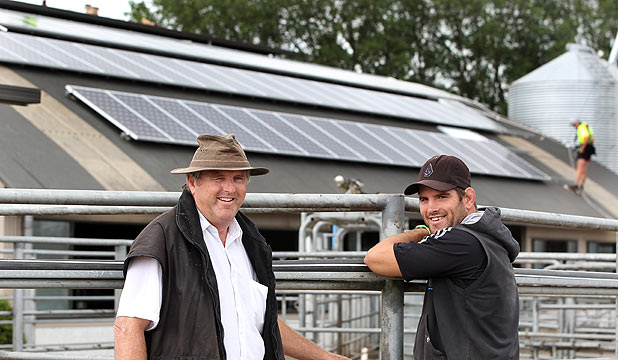 Putaruru farmer Hugh Chisholm and his son, Simon, are having solar panels installed on theirr milking shed.