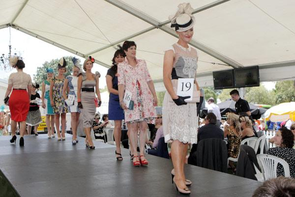 Fashion in the Field contestants strut their stuff for the judges.