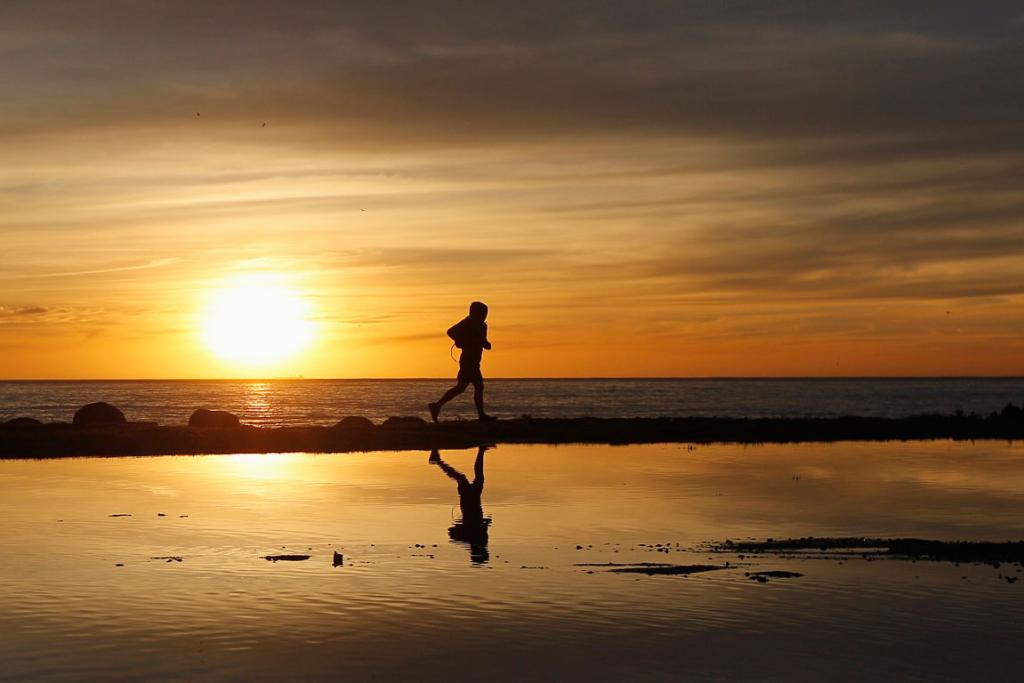 A man jogs during a sunset along the coast in Valparaiso city.