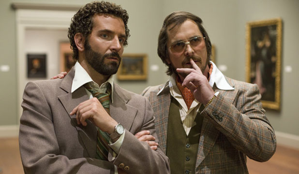 HUSTLERS: Bradley Cooper, as Richie Dimaso, and Christian Bale's Irving Rosenfeld in American Hustle.