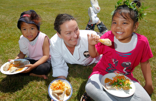 FESTIVE FOOD: Rachel Priestley tucks into a meal with sisters Jasmine Tahaih, 5, and Galaxy, 7. Ms Priestley teamed up with Julia Milne to put on a Christmas lunch for the children at Epuni School.