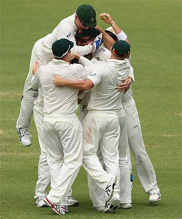 ON TOP AGAIN: Australia players celebrate after dismissing Tim Bresnan.