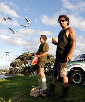 WHERE'S YA BIN: Gavin Hill, left, and Donny Mattock grab a bite at Mt Bryan Domain, and agree  the bins should be brought back.