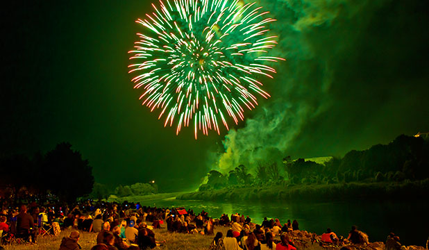 RIVERSIDE TREAT: People gather to watch a fireworks display from Anzac Park in Palmerston North.