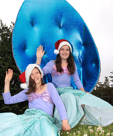 SEASIDE FLAVOUR:  Olivia Black, left, and Sydney Wells, both 11, show off their mermaid costumes for Riverton's 18th Christmas parade.