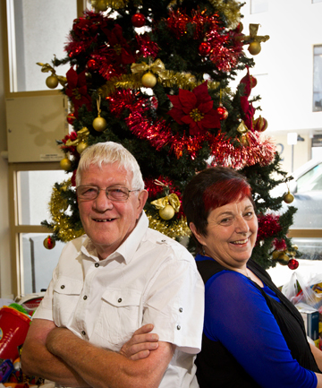 CHRISTMAS CHEER: Peter and Sandra Maxfield are spending their 24th Christmas volunteering at The Mayor's Christmas Dinner.