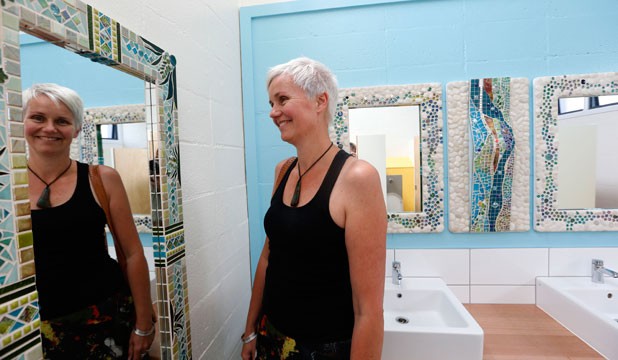 Miranda Reihana is impressed by the new mirrors in the  refurbished Buxton Square toilets.
