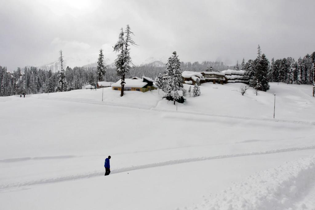 A Kashmiri man walks through snow in Gulmarg, west of Srinagar.