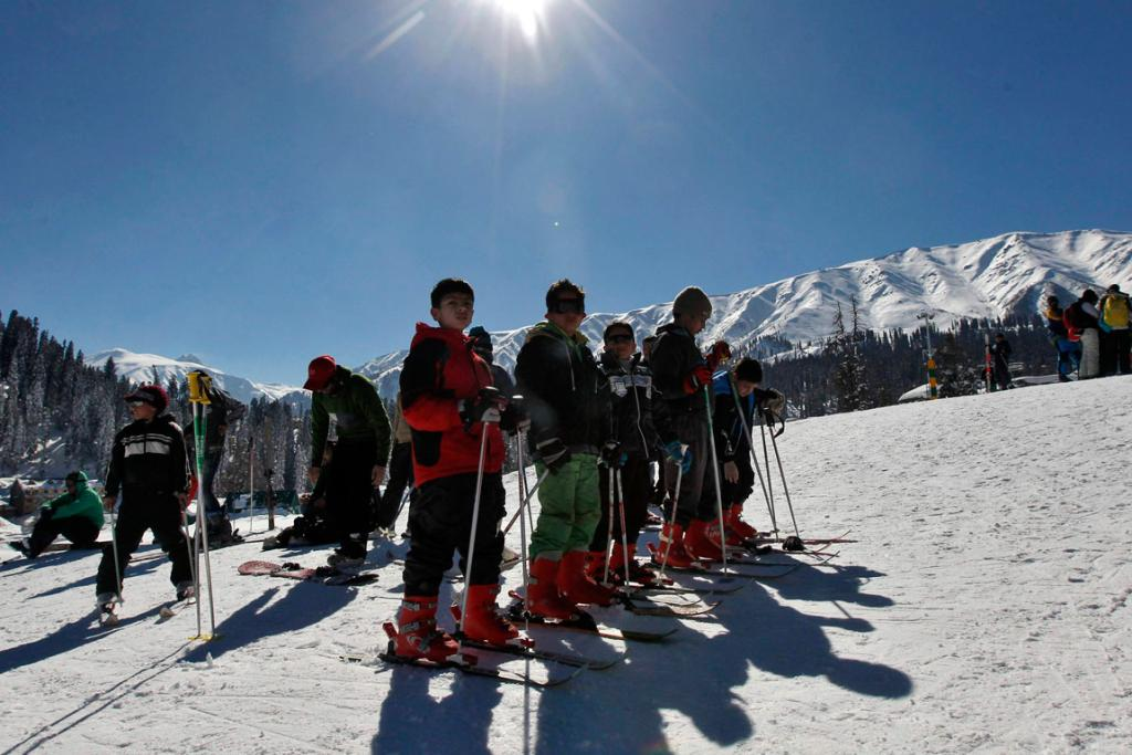 Kashmiri boys wait to practice skiing in Gulmarg.