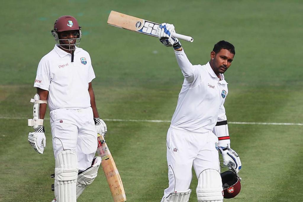 Denesh Ramdin waves his bat after scoring a century at Seddon Park.