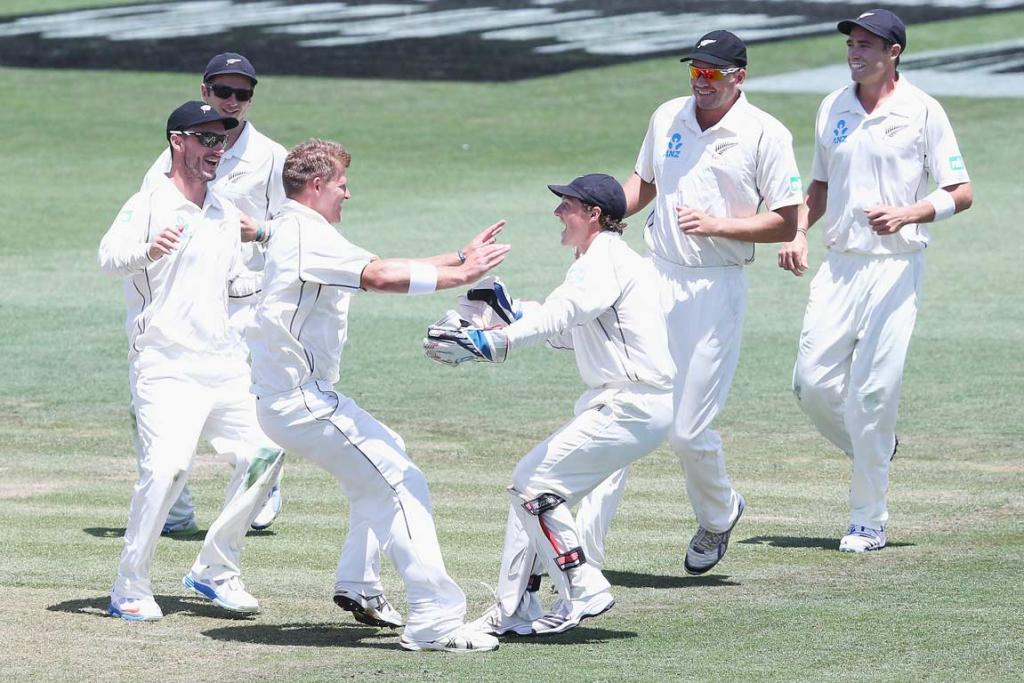 Black Caps players rush to Corey Anderson after he dismissed Marlon Samuels.