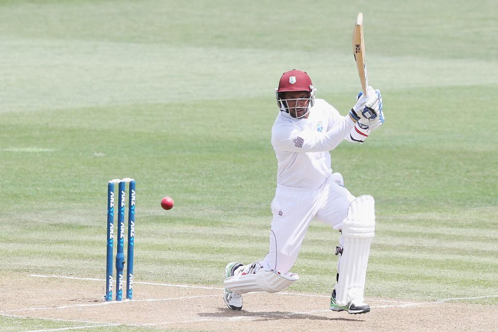 Dinesh Ramdin plays a cover drive.
