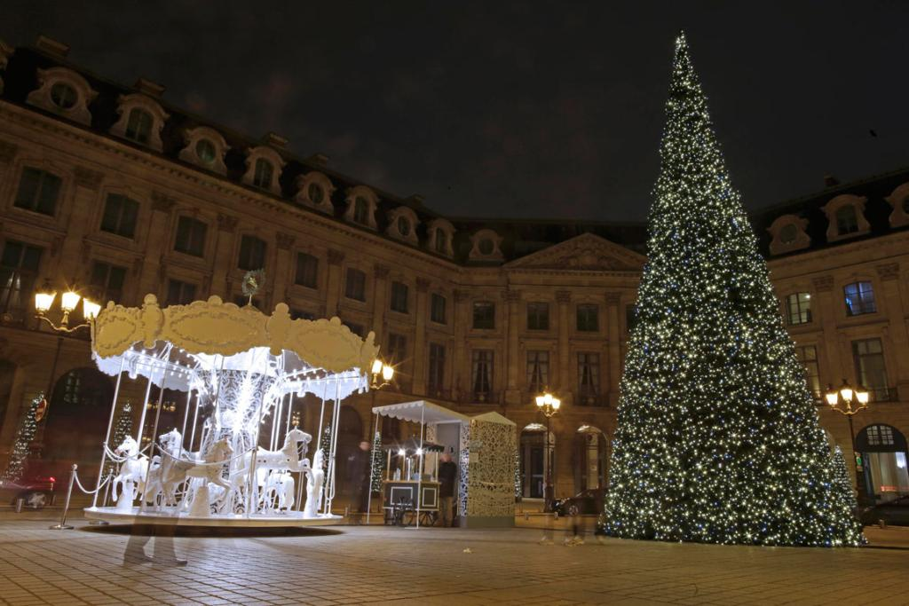 A Christmas tree and a merry-go-round are seen in the Place Vendome in Paris as holiday season decorations are in place for tourists and shoppers in the French capital.
