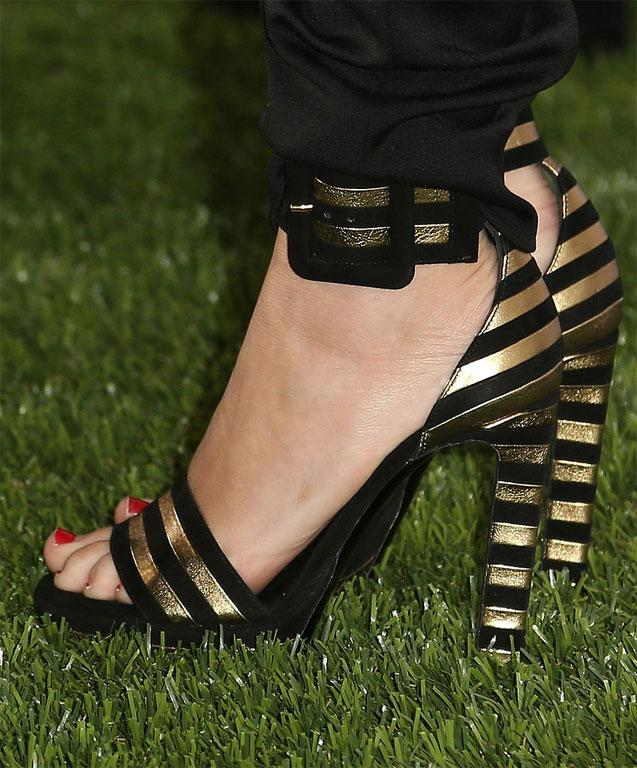 To accept her Maxim honour this year, Miley Cyrus picked black-and-gold striped sandals.