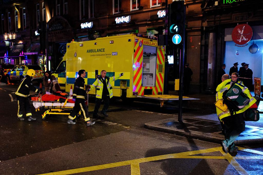 A person injured by a roof collapse at the Apollo Theatre is stretchered away by emergency services.