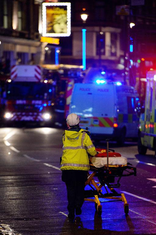 Emergency services at the scene of a roof collapse at the Apollo Theatre in London.