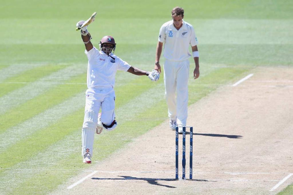 Shivnarine Chanderpaul leaps in the air to celebrate his century on day two of the third test.