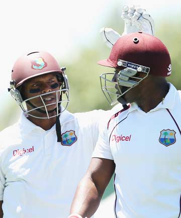STRONG TOTAL: Shivnarine Chanderpaul and Tino Best walk off after the West Indies posted 367 in their first innings at Hamilton.