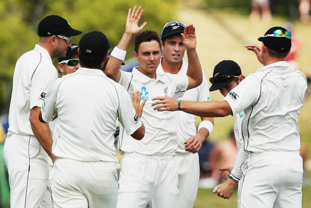 Trent Boult gets congratulated on one of his four wickets in the West Indies' second innings.