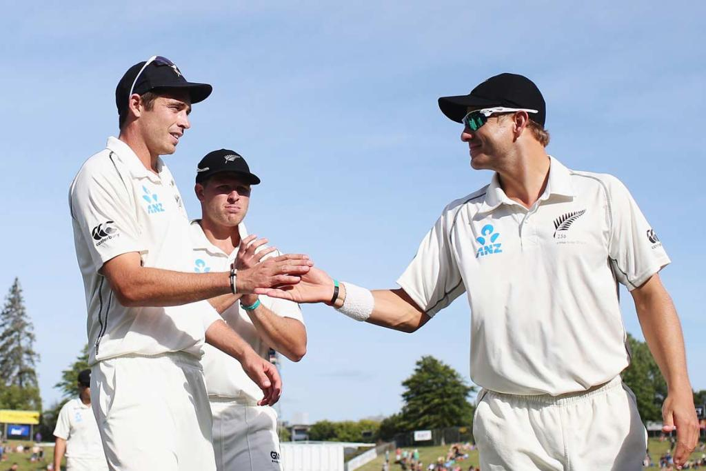 Tim Southee and Neil Wagner high-five after New Zealand dismissed the West Indies for 103 in their second innings.