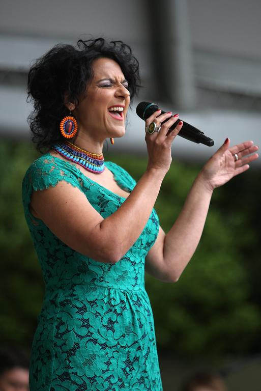 New Zealand entertainer Jackie Clarke takes to the stage at Christmas on the Bay, where she belted out a tune for the occasion.