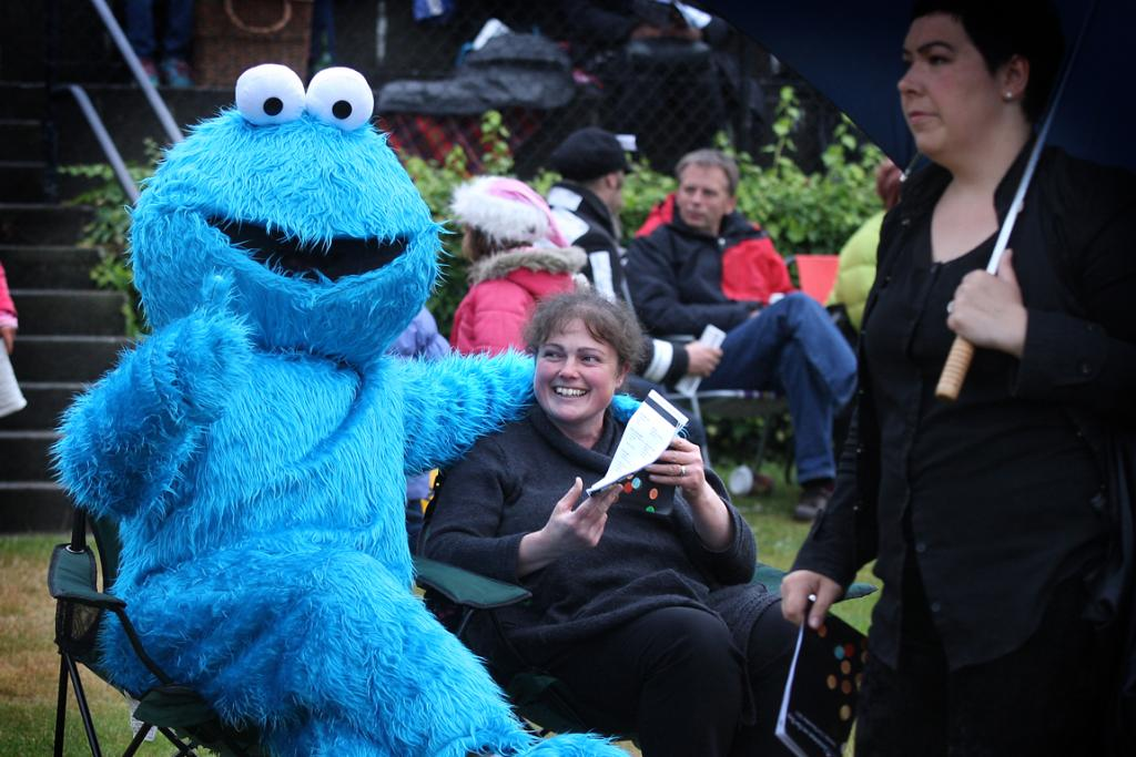 Cookie Monster stands out in the crowd as he gives Jo Lyne a hug during Christmas on the Bay 2013.