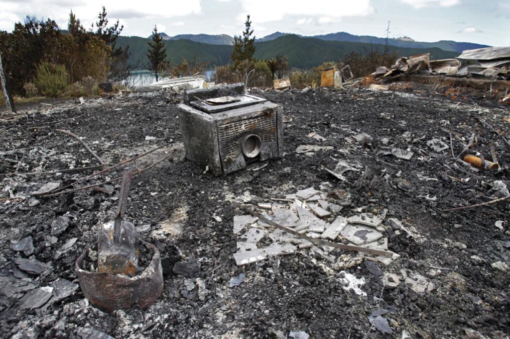 Little remains of a home destroyed in the Port Underwood fire.