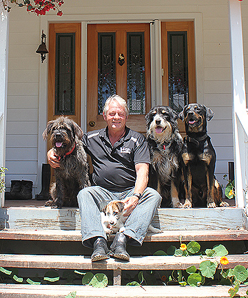 GOOD COMPANY: Mark Vette hangs out at his Waimauku home with Tommy the terrier, front, and from left, Monty, Blue, and Smitty.