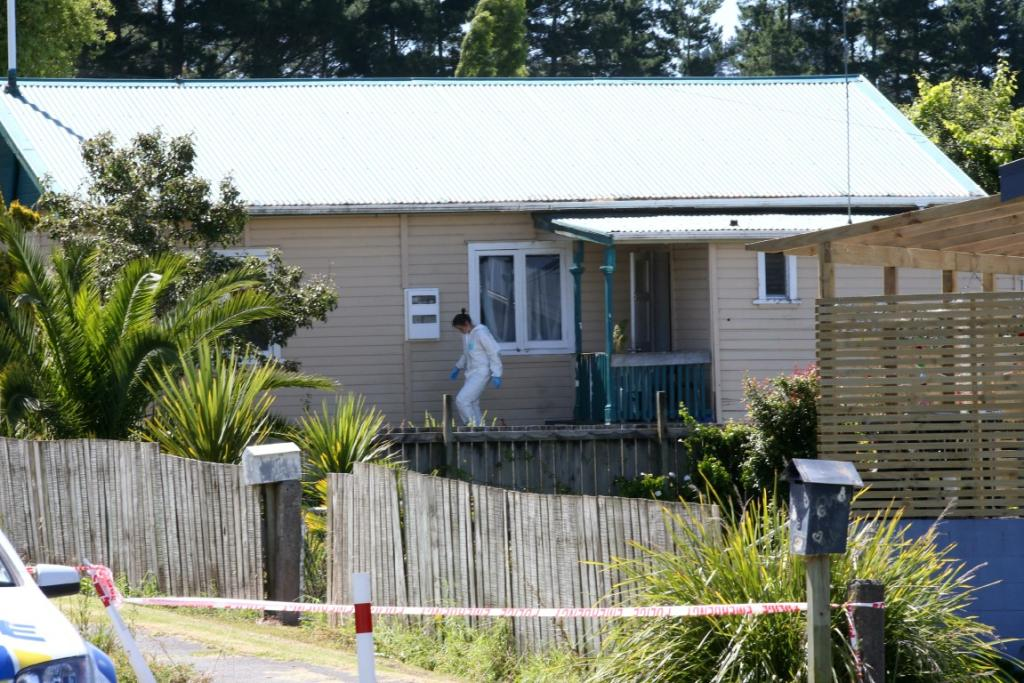 WOMAN'S DEATH: Police around the cordoned off scene of a suspected homicide in Coronation Street, Te Hana, North of Auckland.