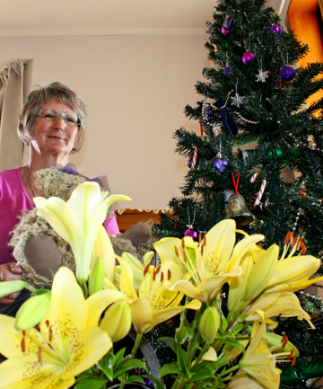 Christmas cheer: Robyn Dawson, of Blind River, with her first Christmas tree in more than 10 years and lilies from a friend