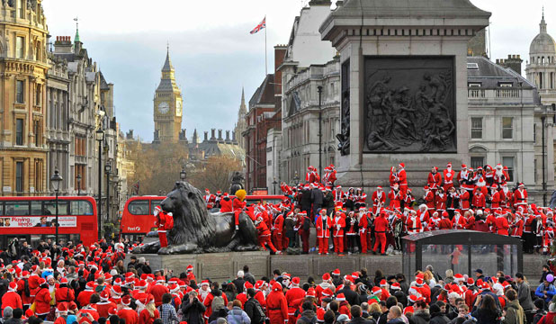 XMAS IN EUROPE: Hundreds of revellers dressed in Santa outfits assemble around Trafalgar Square in central London.