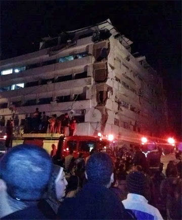 A damaged area is seen after an explosion at a security building in Mansoura city, the capital of Dakahlyia Governorate.