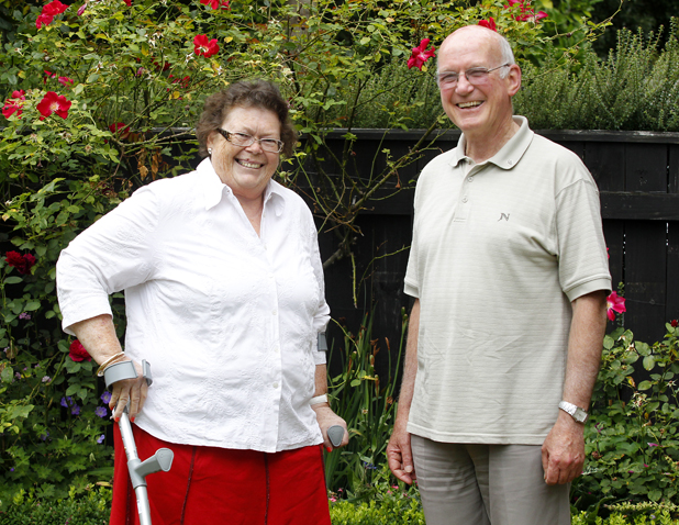 Lucky escape: Belinda Vavasour and St Mary's Church priest Father Aidan Kay who survived a nightmare crash on State Highway 6 last week