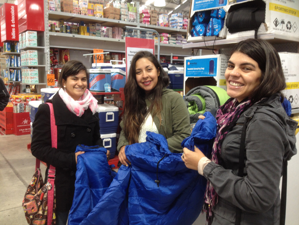 Fabiola Belmar, Paula Castillo, Layla Yapur, all of Chile, shopping for camping gear at the Warehouse in Blenheim on Boxing Day