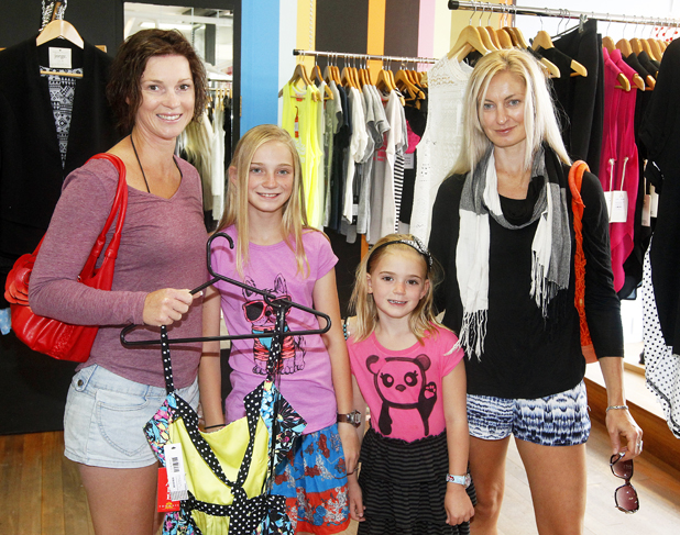 Mandy Pearcy, Isobel Pearcy, 10, and Colbie Pearcy, 5, all of Nelson, and Catherine Pearcy, of Blenheim, shop at Thomas's Department Store in Blenheim during Boxing Day.