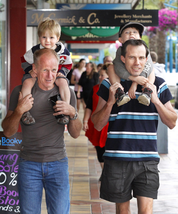 Graeme Andrews (from Blenheim) holding grandson Cameron McMurachy (2) and Ben McMurachy (from Canada) holding son Branden McMurachy (5).